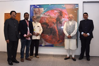 Prime Minister Narendra Modi and Maharashtra CM Devendra Fadanvis and the Governor and next to him is Ratnadeep, curator for the show.